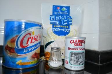 Tortilla ingredients - Flour, shortening, salt, baking powder, and hot water. 3 1/2 - 4 cups of flour