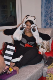 Monica with her Panda hat and attached paw gloves... she's driving us nuts with it.