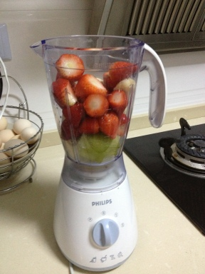 To make the smoothies, add fruit to the blender