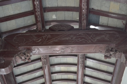 Wood detailed carvings can be seen under the awning.