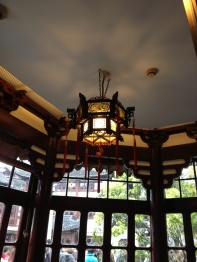 This lantern is black but many were red through out the building.