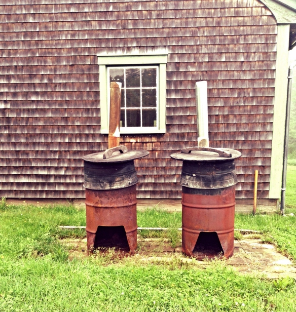 The Cadillac way of baking lobster! Firewood is inserted through the holes at the bottom of the barrel. At the top are 2 tubs that are filled with a little water then the lobster is put in to bake.