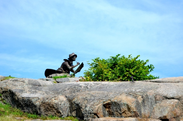 This sculpture is located at the top of Duncan Hill overlooking Gloucester Harbor. The sculpture is called Fitz Hugh Lane Sculpture by Alfred N. Duca.