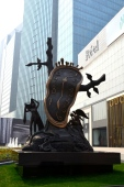 This statue is located in the West Nanjing area of Shanghai, China. The inscription read that this bronze piece was created by Salvador Dali in Switzerland. This is supposed to be one of two pieces with the second located in London.