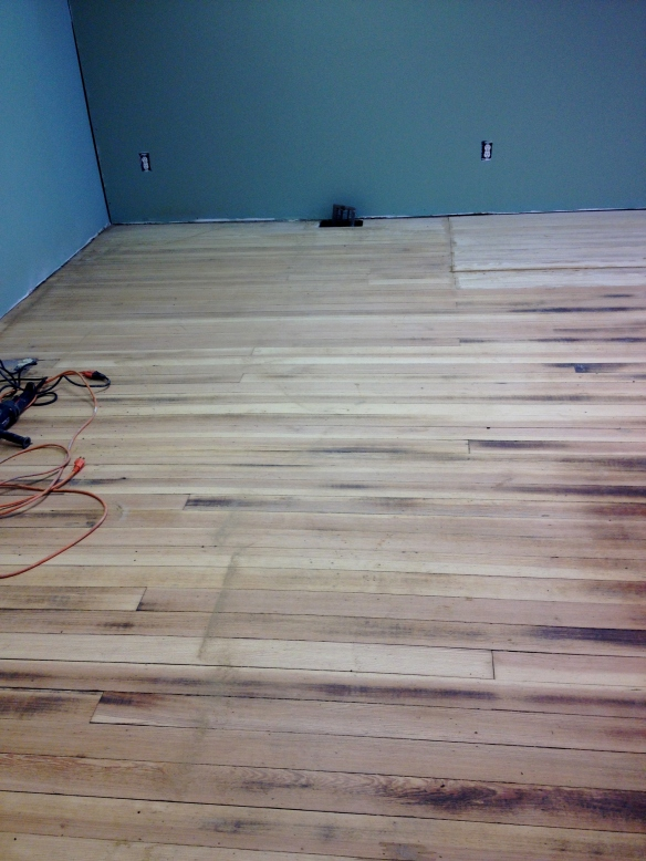 This is after all the glue has been removed and the floors have been sanded. We could see the promise of beauty to come.